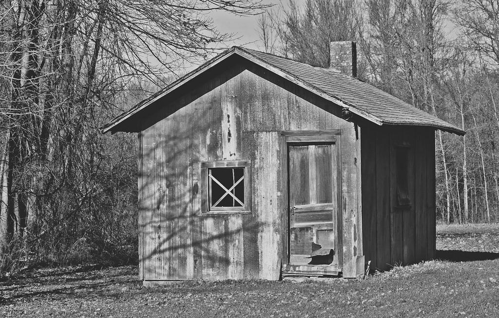 Dirt road hump shack.