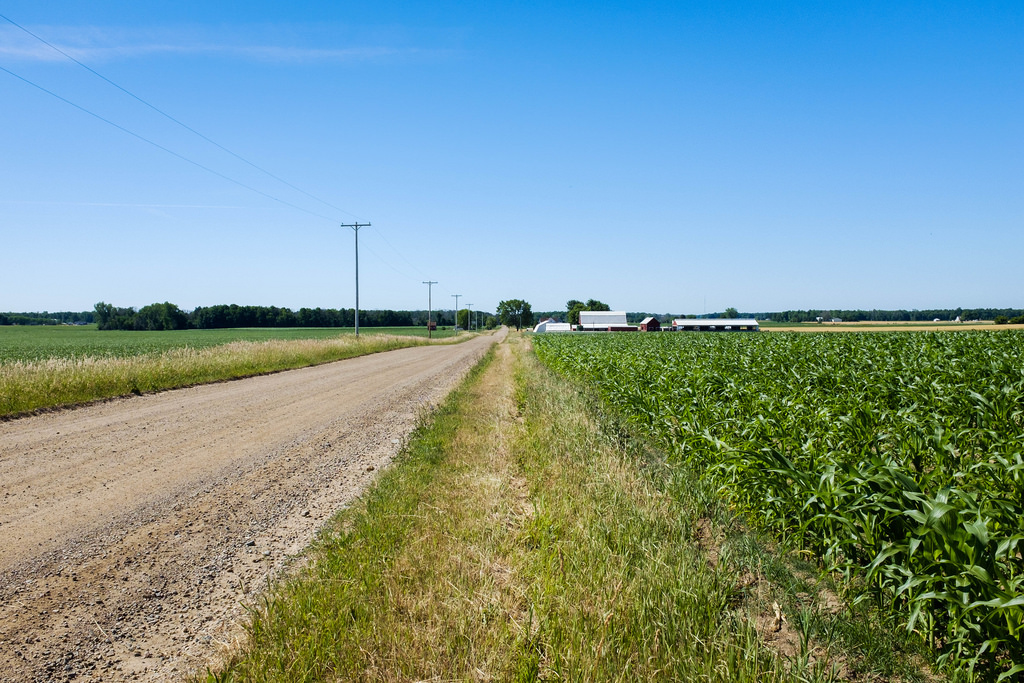 flat-gravel-road-and-farm